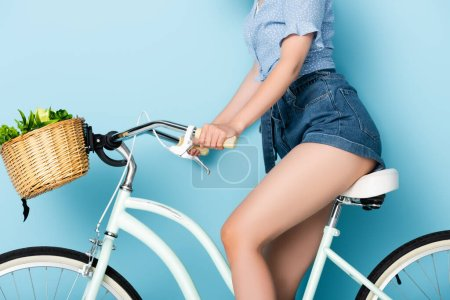 Photo for Cropped view of young woman riding bicycle - Royalty Free Image