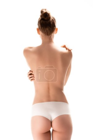 Photo for Back view of woman standing and touching perfect body isolated on white - Royalty Free Image
