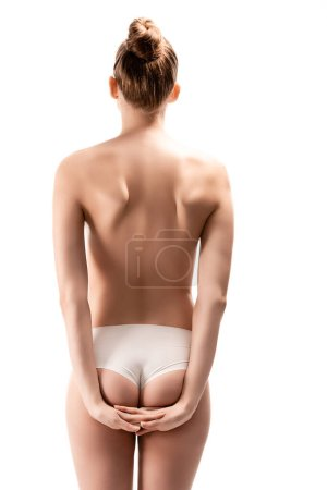 back view of woman in panties standing with crossed arms behind back isolated on white