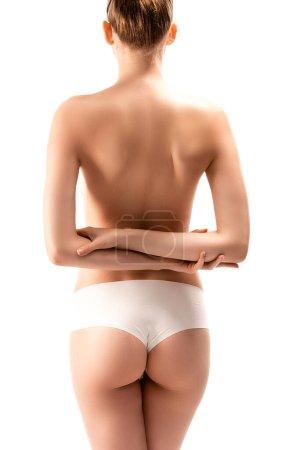 Photo pour Vue arrière de la femme en culotte debout avec les bras croisés derrière le dos isolé sur blanc - image libre de droit