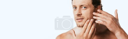 Horizontal image of shirtless man touching skin on cheek isolated on white