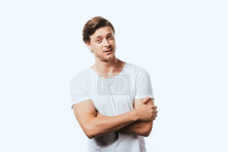 Confident man with crossed arms looking at camera isolated on white