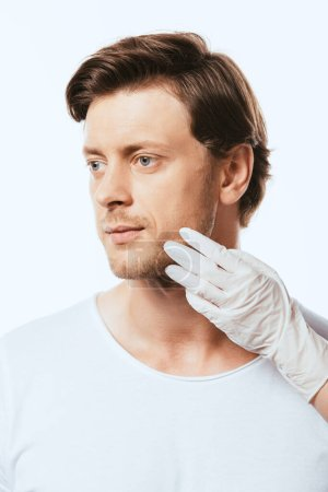 Dermatologist touching skin on face of patient isolated on white