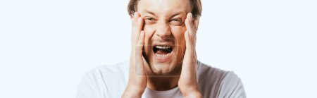 Photo for Panoramic shot of scared man with hands near face isolated on white - Royalty Free Image