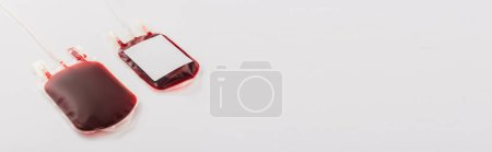 Photo for Blood donation packages with blank label on white background, panoramic shot - Royalty Free Image