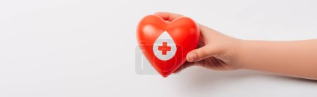 Photo for Cropped view of female hand with red heart on white, blood donation concept - Royalty Free Image