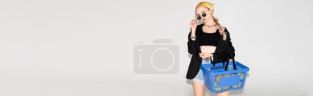 Photo for Fashionable woman posing with blue shopping basket on white background, panoramic shot - Royalty Free Image