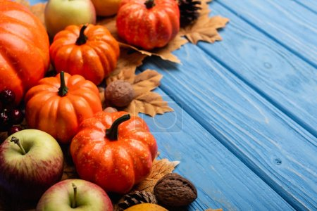 autumnal harvest and foliage on blue wooden background