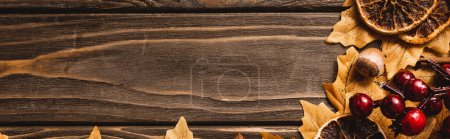 Photo for Top view of autumnal decoration on brown wooden background, panoramic shot - Royalty Free Image