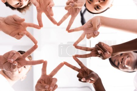 Photo for Bottom view of multiethnic volunteers showing peace gesture - Royalty Free Image