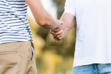 Photo for Cropped view of father and son shaking hands - Royalty Free Image