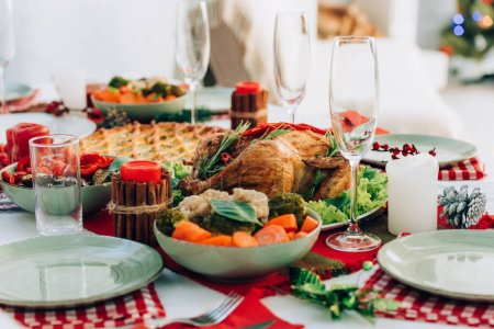 Photo for Selective focus of roasted turkey, pie and cooked vegetables on table served for thanksgiving - Royalty Free Image