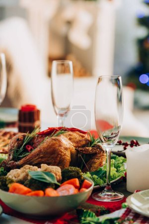 selective focus of table served with delicious turkey and vegetables for thanksgiving dinner