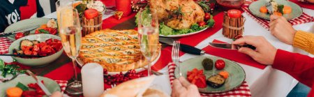 Photo for Panoramic shot of family sitting at festive table with thanksgiving dinner - Royalty Free Image