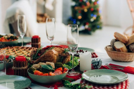Photo for Selective focus of festive table with baked turkey, pie and vegetables - Royalty Free Image