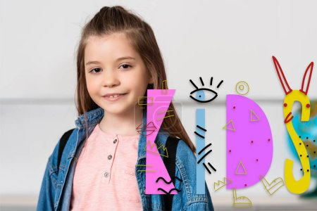 Photo for Schoolgirl looking at camera near kids illustration - Royalty Free Image