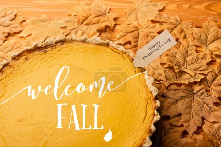 pumpkin pie with welcome fall lettering and happy thanksgiving tag on leaves
