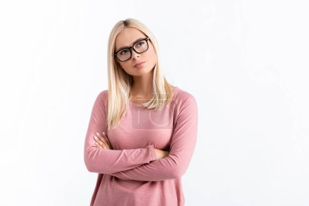 Photo for Pensive woman in eyeglasses standing with crossed arms isolated on white - Royalty Free Image