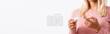 Photo for Cropped view of young woman holding box with contact lenses isolated on white, banner - Royalty Free Image