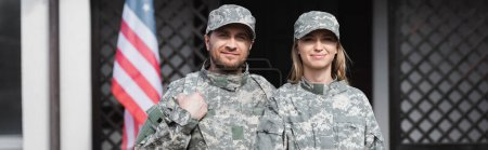 Photo for Smiling military couple looking at camera on blurred background, banner - Royalty Free Image