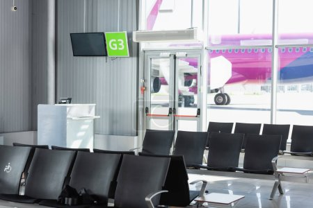 Photo for Black seats in departure lounge in modern airport - Royalty Free Image