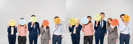 Collage of multicultural businesspeople holding cards with emotions isolated on grey, banner