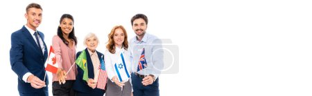 Positive multicultural businesspeople holding flags of countries isolated on white, banner