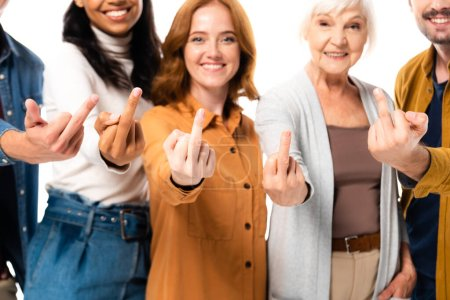 Photo pour Smiling multicultural people showing middle fingers on blurred background isolated on white - image libre de droit