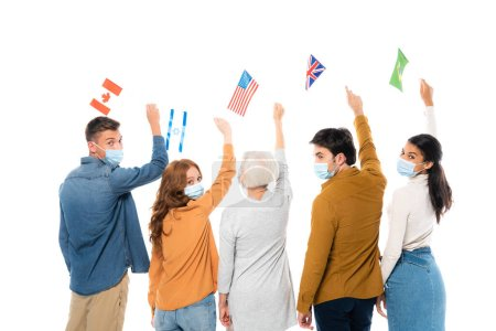 Multiethnic people in medical masks holding flags of countries isolated on white