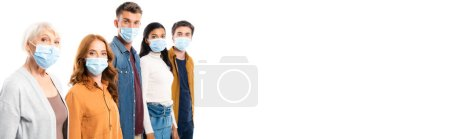 Young people in medical masks looking at camera near multiethnic friends isolated on white, banner