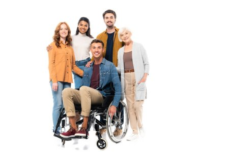 Photo for Multicultural friends hugging near smiling man in wheelchair isolated on white - Royalty Free Image