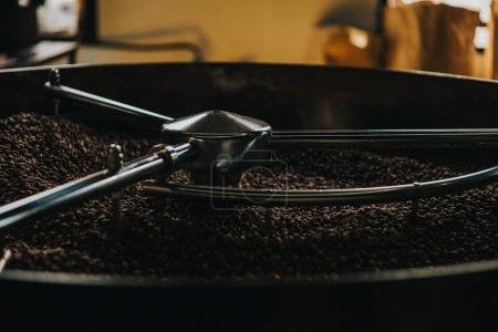 Roasting coffee beans in large coffee roaster