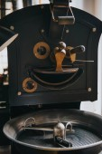 Adjusting handles of machine for professional coffee production