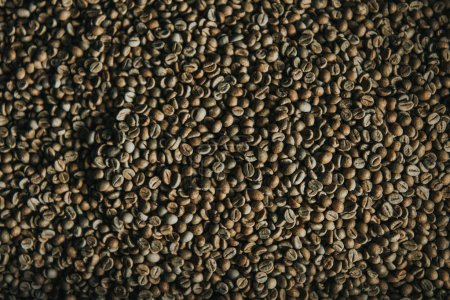 Raw coffee beans in process of roasting texture