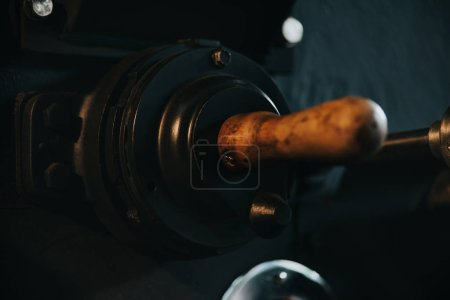 Wooden handle of machine for professional coffee production