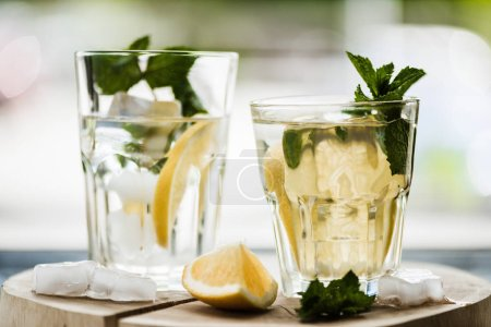 close-up view of two glasses with fresh cold lemonade