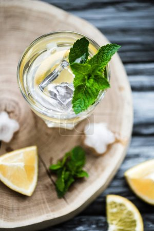 Photo for Top view of cold fresh summer drink with mint and ice cubes in glass - Royalty Free Image
