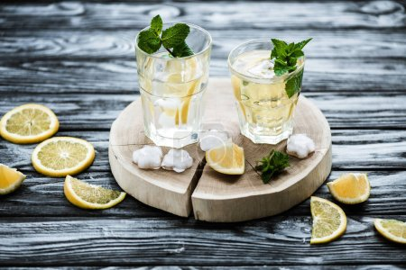 Photo for High angle view of cold fresh summer cocktail with mint and ice cubes in glasses - Royalty Free Image