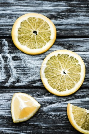 Photo for Top view of slices of fresh lemon on wooden table - Royalty Free Image