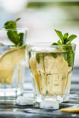 Photo for Close-up view of two glasses with fresh cold mojito cocktail on table - Royalty Free Image