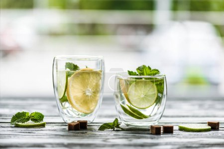 Photo for Close-up view of two glasses with fresh cold mojito on table - Royalty Free Image