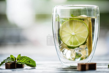 Photo for Close-up view of glass of cold fresh mojito with lime, mint and sugar - Royalty Free Image