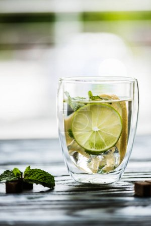 Photo for Glass of cold fresh mojito with lime, mint and sugar - Royalty Free Image