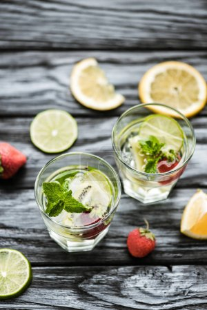 high angle view of delicious summer cocktail in glasses on wooden table