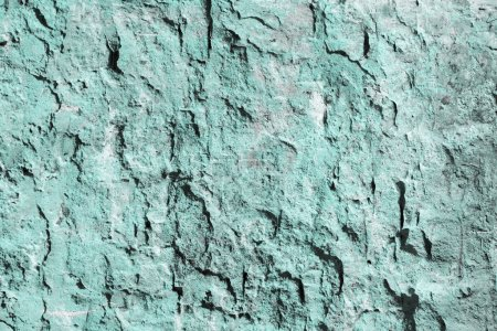 close-up view of light blue weathered wall texture
