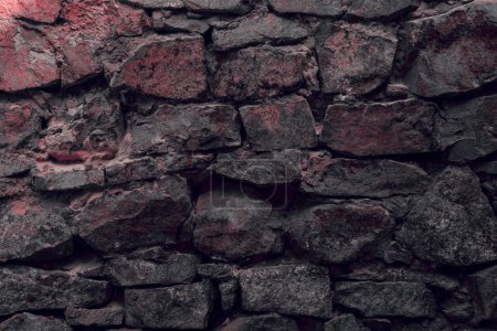 close-up view of old weathered stone wall textured background