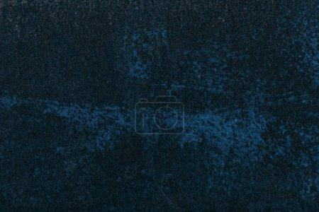 dark blue aged rusty metal textured background