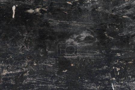 vieux noir tanné texture de mur de ciment