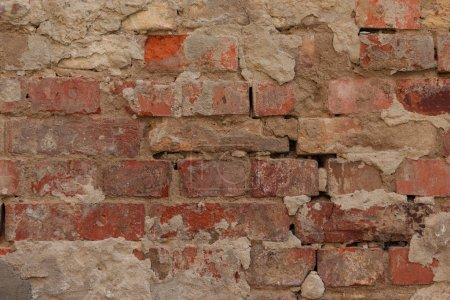 old cracked brown brick wall textured background