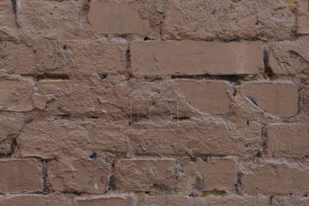 close up view of old cracked brown brick wall textured background